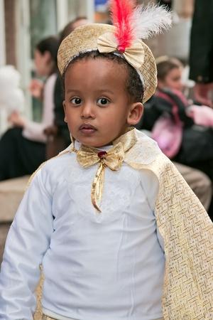 jewish festival: JERUSALEM, ISRAEL - MARCH 15  Purim carnival,Portrait of an unidentified little boy dressed like a prince  March 15, 2006 in Jerusalem, Israel  Purim is celebrated annually