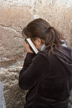 israeli: Praying women at the Wailing Wall in Jerusalem  The Western Wall, Wailing Wall or Kotel is located in the Old City of Jerusalem at the foot of the western side of the Temple Mount    The Wailing Wall is the holiest place for Jews