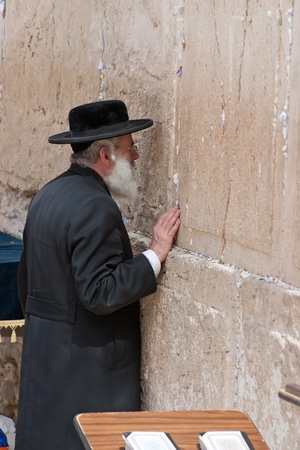 JERUSALEM, ISRAEL - MARCH 14  Prays an unidentified man at the Wailing Wall  March 14, 2006 in Jerusalem, Israel  The Wailing Wall is the holiest place for Jews