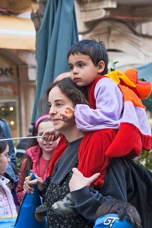 jewish festival: Purim carnival in Jerusalem  Unidentified people watch the show