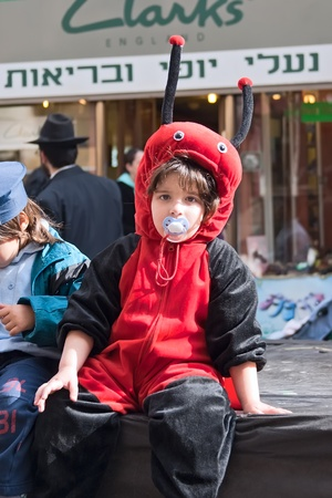 JERUSALEM, ISRAEL - MARCH 15  Purim carnival,Portrait of an unidentified little boy dressed like a ladybird  March 15, 2006 in Jerusalem, Israel  Purim is celebrated annually