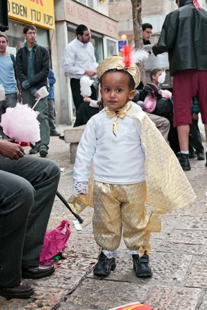 JERUSALEM, ISRAEL - MARCH 15  Purim carnival,Portrait of an unidentified little boy dressed like a prince  March 15, 2006 in Jerusalem, Israel  Purim is celebrated annually
