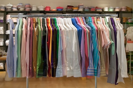 hang up: Multi colored shirts on metal hangers