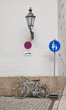 Bicycle standing on a street near the building  Munich, Germany  photo