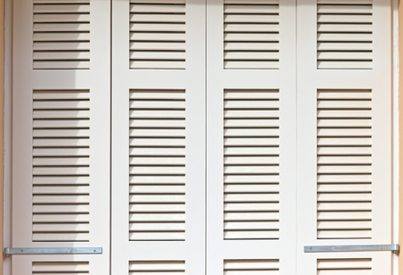 Window with white shutters Stock Photo