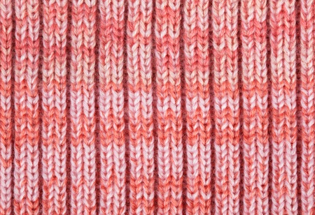 Pink knitted horizontal textured background