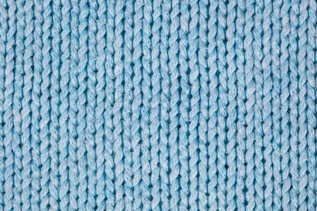 Blue knitted horizontal textured background  photo