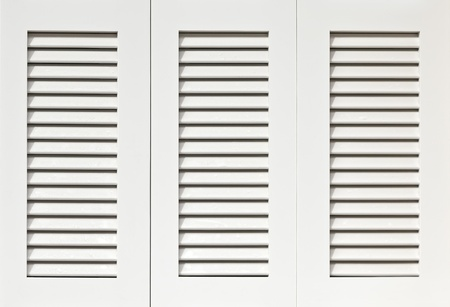 Window with white shutters photo