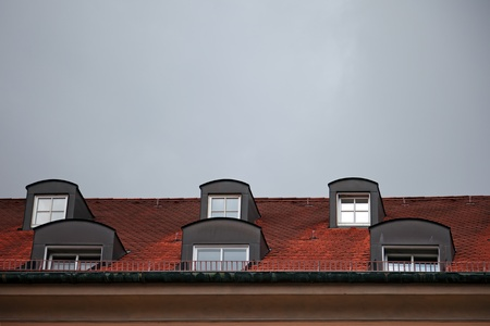 Close-up of red roof tiles with windows in Munich, Germany  photo