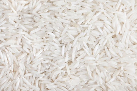 basmati: Rice white long-grain texture background  Indian basmati rise  Stock Photo