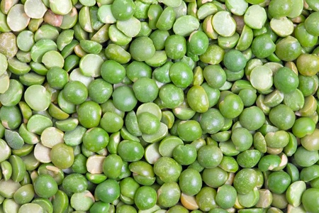 Dry split green peas texture background  Great for soups, puree  photo