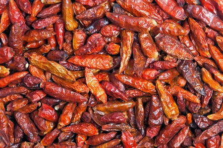 cayenne: Dried Cayenne pepper texture background  Also called Guinea spice, cow-horn pepper, aleva, bird pepper,  red pepper, hot chili pepper  Used to flavor dishes and for medicinal purposes