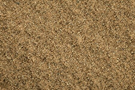 Cumin ground texture, full frame background  Second most popular spice in the world after black pepper  photo