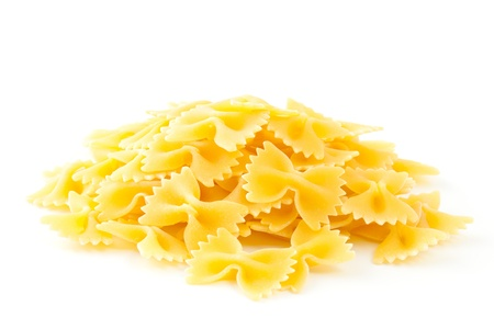 Heap Farfalle pasta isolated on white background  Pasta is a staple food of traditional Italian cuisine