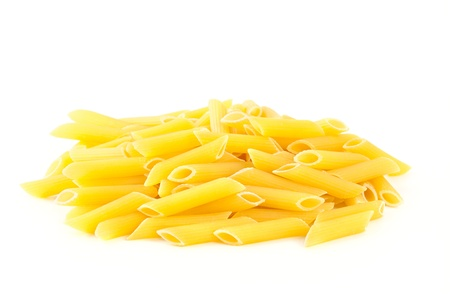 short pasta: Heap Pasta Penne isolated on white background  Pasta is a staple food of traditional Italian cuisine