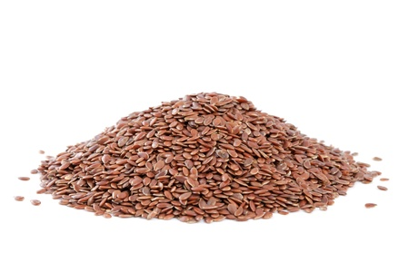 Heap Flax seeds  Linum usitatissimum  isolated on white background  Also called common flax or linseed  Used as an ingredient in paints, fiber and cattle feed, produce a vegetable oil  The plant is also used in medicine