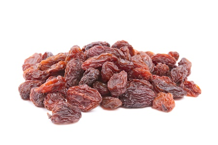 raisins: Heap Raisins isolated on white background  Used in cooking, baking and brewing, may be eaten raw