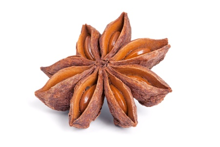 anise: Anise star  Illicium verum  isolated on white background  Also called Star aniseed, or Chinese star anise  Used as a spice in cuisines all over the world  The plant is also used in medicine
