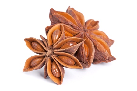 badiane: Anise star  Illicium verum  isolated on white background  Also called Star aniseed, or Chinese star anise  Used as a spice in cuisines all over the world  The plant is also used in medicine