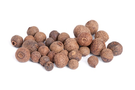 Pile Allspice  jamaica pepper  isolated on white background  Used as a spice in cuisines all over the world  The plant is also used in medicine  Stock Photo