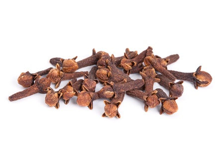 Pile Clove  Syzygium aromaticum  isolated on white background  Used as a spice in cuisines all over the world  The plant is also used in medicine  Stock Photo