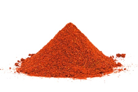 chilli: Pile of ground Paprika isolated on white background  Used to color rices, stews, and soups, meats  Stock Photo