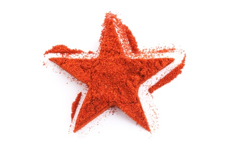 cayenne: Pile of ground Paprika isolated in star shape on white background Stock Photo