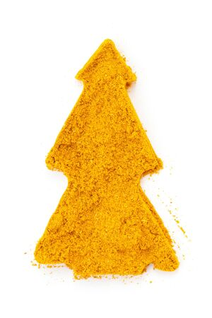 Heap ground Curry  Madras Curry  isolated in christmas tree shape on white background photo