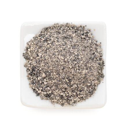 peppercorns: Black peppercorns ground  Piper nigrum  in a white bowl