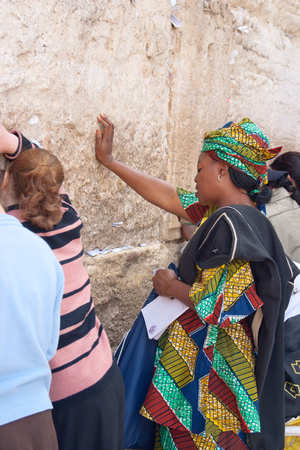 kotel: JERUSALEM, ISRAEL - MARCH 14, 2006  A women pray at the Wailing Wall  The Western Wall, Wailing Wall or Kotel is located in the Old City of Jerusalem at the foot of the western side of the Temple Mount  Editorial