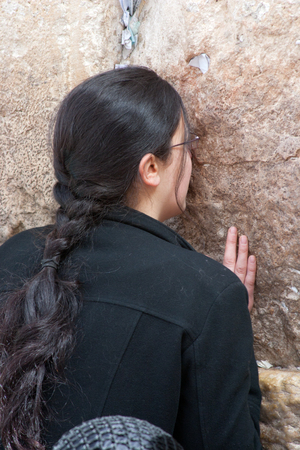 JERUSALEM, ISRAEL - MARCH 14, 2006  A woman prays at the Wailing Wall  The Western Wall, Wailing Wall or Kotel is located in the Old City of Jerusalem at the foot of the western side of the Temple Mount
