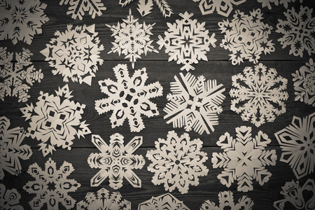 Christmas wooden background with snowflakes photo