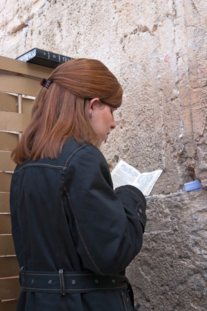 jewish ethnicity: JERUSALEM, ISRAEL-MARCH 14, 2006:A woman prays at the Wailing Wall. The Western Wall, Wailing Wall or Kotel is located in the Old City of Jerusalem at the foot of the western side of the Temple Mount.