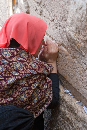 JERUSALEM, ISRAEL-MARCH 14, 2006:A woman prays at the Wailing Wall. The Western Wall, Wailing Wall or Kotel is located in the Old City of Jerusalem at the foot of the western side of the Temple Mount.