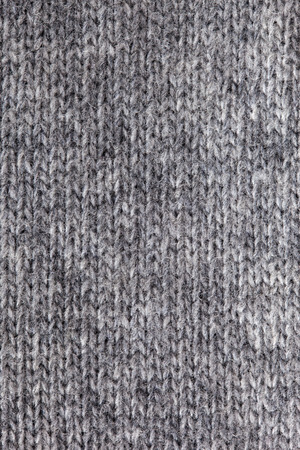 Gray knitted textured background photo