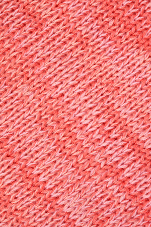 Pink - Peach knitted textured background photo