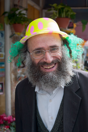 jewish culture: JERUSALEM, ISRAEL - MARCH 15, 2006: Purim carnival in the famous ultra-orthodox quarter of Jerusalem - Mea Shearim. Portrait of  men dressed in traditional Jewish clothing. On his head wearing a cap. Purim is celebrated annually according to the Hebrew ca Editorial