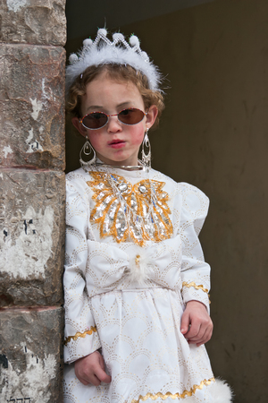 shearim: JERUSALEM, ISRAEL - MARCH 15, 2006: Purim carnival in the famous ultra-orthodox quarter of Jerusalem - Mea Shearim. Portrait of young girl dressed in a princess costume. Purim is celebrated annually according to the Hebrew calendar. Purim is the custom of Editorial