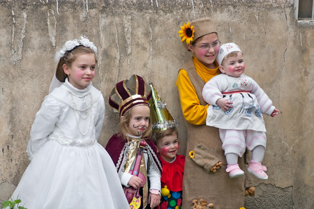 purim: JERUSALEM, ISRAEL - MARCH 15, 2006: Purim carnival in the famous ultra-orthodox quarter of Jerusalem - Mea Shearim. Group portrait of five children dressed in carnival costumes. Purim is celebrated annually according to the Hebrew calendar. Purim is the c