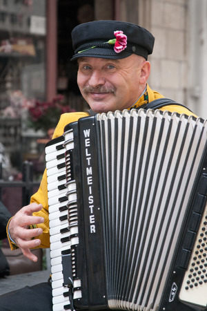 masquerading: JERUSALEM, ISRAEL - MARCH 15, 2006: Purim carnival, street musician plays the accordion. Purim is celebrated annually according to the Hebrew calendar. Purim is the custom of masquerading in costume and the wearing of masks. Editorial