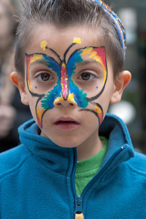 masquerading: JERUSALEM, ISRAEL - MARCH 15, 2006: Purim carnival, portrait of little boy on his face painted butterfly. Purim is celebrated annually according to the Hebrew calendar. Purim is the custom of masquerading in costume and the wearing of masks. Editorial
