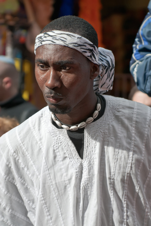 masquerading: JERUSALEM, ISRAEL - MARCH 15, 2006: Purim carnival. Portrait of a man. On his head he tied round bandanna around his neck a necklace of shells. Purim is celebrated annually according to the Hebrew calendar. Purim is the custom of masquerading in costume a