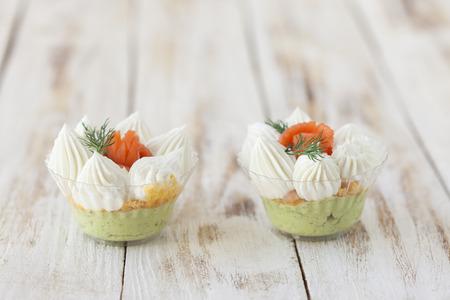 mascarpone: Salmon salted trifle snack with avocado cream and cream fresh Stock Photo