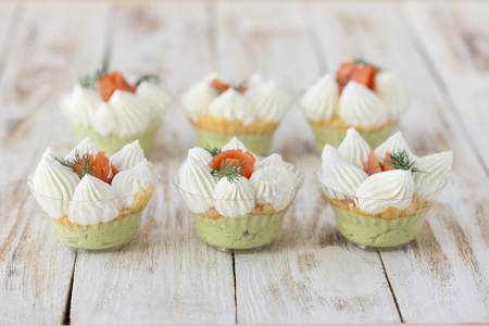 trifle: Salmon salted trifle snack with avocado cream and cream fresh Stock Photo