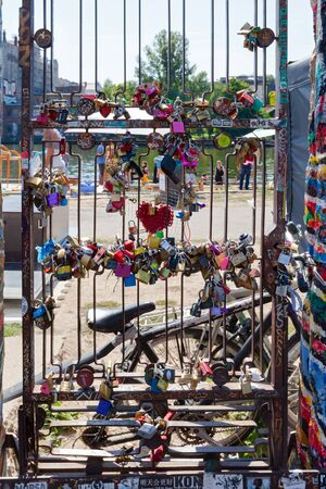 BERLIN, GERMANY : AUGUST 19 ,2018: Berliner Wall ( Mauer ) East Side Gallery. Open-air gallery in Berlin. A gate made in a hole on a wall, memory where people put padlocks for luck and love. In Berlin, Germany. It consists of a series of murals painted di