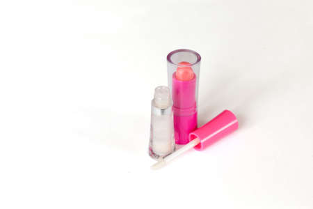 gloss: Pink lipstick  and lip gloss in the open case isolated on white Stock Photo