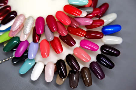 A collection of nail polish testers in various colors photo