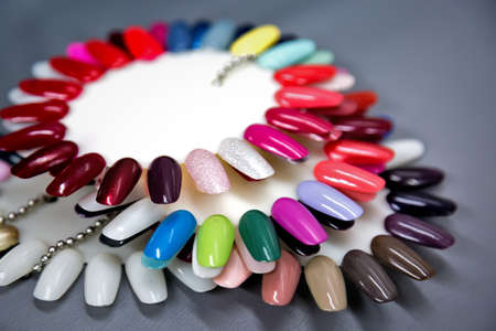 A collection of nail polish testers in various colors