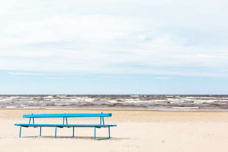 jurmala: A bench in the sand at the beach in Jurmala Stock Photo