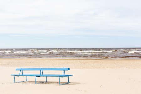 jurmala: A bench in the sand at the beach in Jurmala Stock Photo